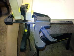 Close up picture of the clamps holding the door sections at right angles to each other