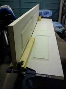 Picture of door panels clamped at 90 degrees to each other to ease planing the sawn edge