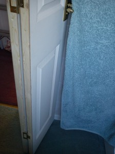 Alternative view of bifold bathroom door folded back on itself