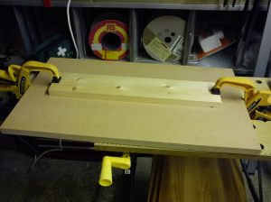Length of timber clamped to MDF prior to drilling and glueing
