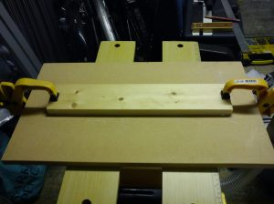 Length of timber glued and screwed to MDF