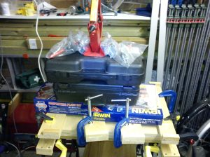 Two layers of MDF clamped together and weighted down with heavy tools