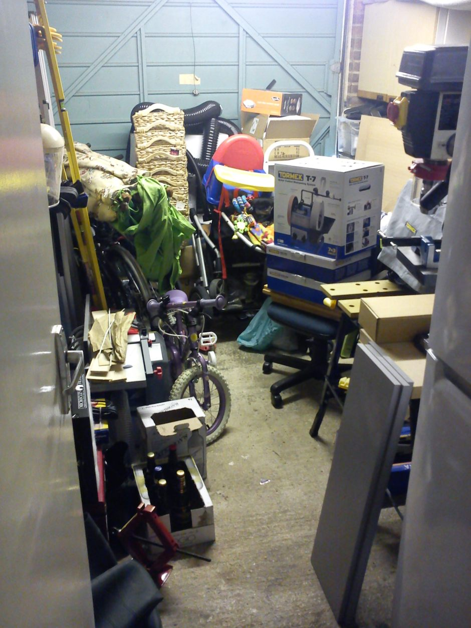 Single garage workshop full of clutter