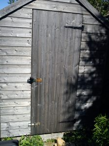 Shed with bolt moved to bottom of door and hasp installed