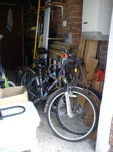 Bikes in their old home by the central heating boiler in the garage