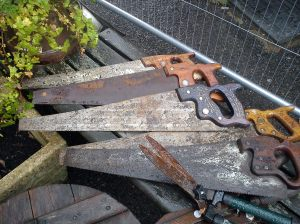 Saws for sale outside in the rain