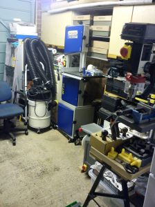 Workshop with Charnwood W730 bandsaw against wall in alcove