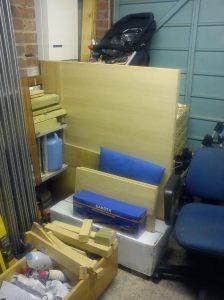 Veneered MDF stored across the garage
