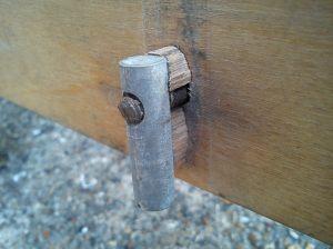 Barrel nut with bits of broken stretcher