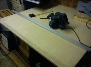 Cutting plywood on large workbench