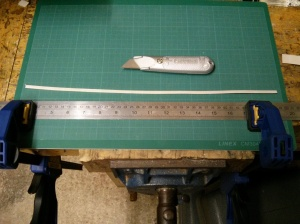 Cut strip of slick tape